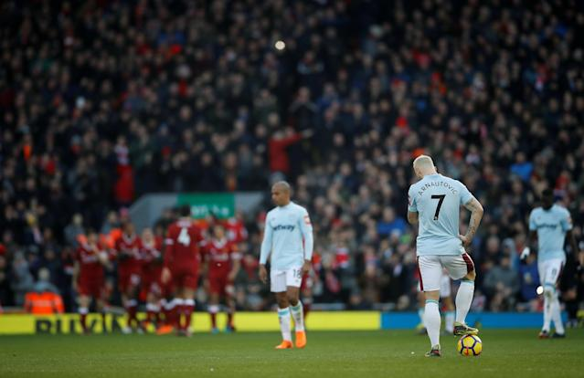 """Soccer Football - Premier League - Liverpool vs West Ham United - Anfield, Liverpool, Britain - February 24, 2018 West Ham United's Marko Arnautovic looks dejected as Liverpool celebrate a goal Action Images via Reuters/Carl Recine EDITORIAL USE ONLY. No use with unauthorized audio, video, data, fixture lists, club/league logos or """"live"""" services. Online in-match use limited to 75 images, no video emulation. No use in betting, games or single club/league/player publications. Please contact your account representative for further details."""