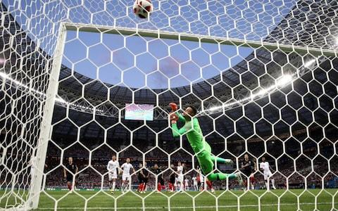<span>Kieran Trippier of England scores past Danijel Subasic of Croatia</span> <span>Credit: Getty </span>