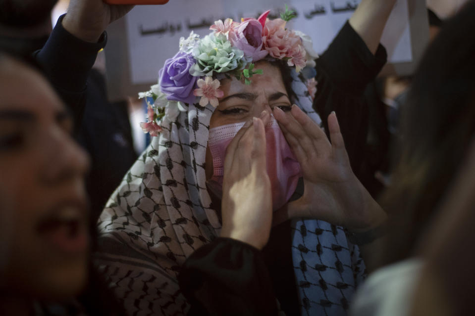Palestinians chant slogans during a protest against the forcible eviction of Palestinians from their homes in the Sheikh Jarrah neighborhood of east Jerusalem, in the West Bank city of Ramallah, Sunday, May 9, 2021. (AP Photo/Majdi Mohammed)