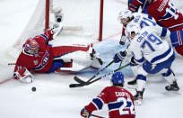 Montreal Canadiens goaltender Carey Price makes a save as Tampa Bay Lightning's Ross Colton and Anthony Cirelli looks for the rebound during the first period of Game 3 of the NHL hockey Stanley Cup Final, Friday, July 2, 2021, in Montreal. (Paul Chiasson/The Canadian Press via AP)