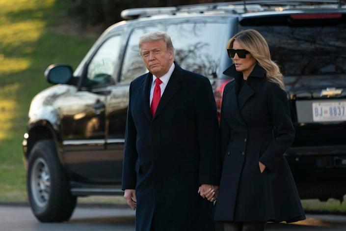 President Donald Trump and First lady Melania Trump depart the White House on 23 December 2020 (EPA-EFE)