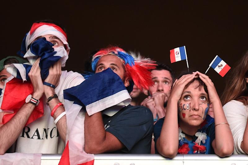 France's supporters react following the Euro 2016 final football match between France and Portugal at the fan zone in Bordeaux on July 10, 2016