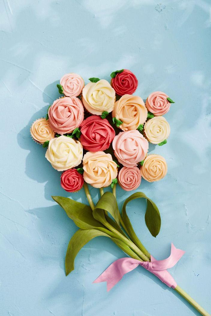 """<p>If you ask us, the best bouquets are made of buttercream. Dazzle Mom by adding real tulip stems and leaves to make an edible bouquet.</p><p><strong><a href=""""https://www.countryliving.com/food-drinks/a35913119/vanilla-cupcakes-with-buttercream/"""" rel=""""nofollow noopener"""" target=""""_blank"""" data-ylk=""""slk:Get the recipe"""" class=""""link rapid-noclick-resp"""">Get the recipe</a>.</strong></p>"""