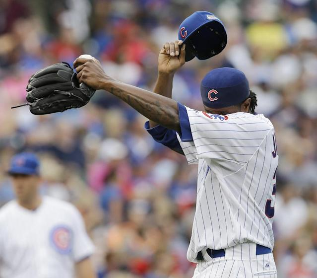 Chicago Cubs starter Edwin Jackson wipes his face after Atlanta Braves' Chris Johnson hit a two-run double during the fourth inning of a baseball game in Chicago, Saturday, July 12, 2014. (AP Photo/Nam Y. Huh)