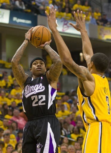 Sacramento Kings' Isaiah Thomas puts up a shot in the first quarter against Indiana Pacers' George Hill, Saturday, Nov. 3, 2012, in Indianapolis. (AP Photo/Doug McSchooler)