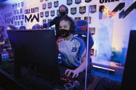 "Boise State esports coach Doc Haskell watches scholarship graduate student Artie ""N3rdybird"" Rainn compete in a match in Boise, Idaho, on Thursday, March 4, 2021. (AP Photo/Otto Kitsinger)"
