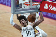 New Orleans Pelicans center Jaxson Hayes (10) slam dunks in the second half of an NBA basketball game against the LA Clippers in New Orleans, Monday, April 26, 2021. The Pelicans won 120-103. (AP Photo/Gerald Herbert)