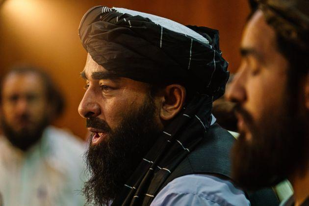 KABUL, AFGHANISTAN -- AUGUST 17, 2021: Zabihullah Mujahid, the Taliban spokesman for nearly 2 decades who worked in the shadows, makes his first-ever public appearance to address concerns about the Taliban' reputation with women's education, appearance and rights, television music and executions, during a press conference in Kabul, Afghanistan, Tuesday, Aug. 17, 2021. (MARCUS YAM / LOS ANGELES TIMES) (Photo: Marcus Yam via Getty Images)