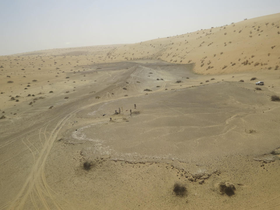 This undated photo provided by the Palaeodeserts Project in September 2021 shows the site of Khall Amayshan 4 in northern Saudi Arabia, where evidence of repeated visits by early humans over the last 400,000 years was found, associated with the remains of ancient lakes. (Michael Petraglia/Palaeodeserts Project via AP)