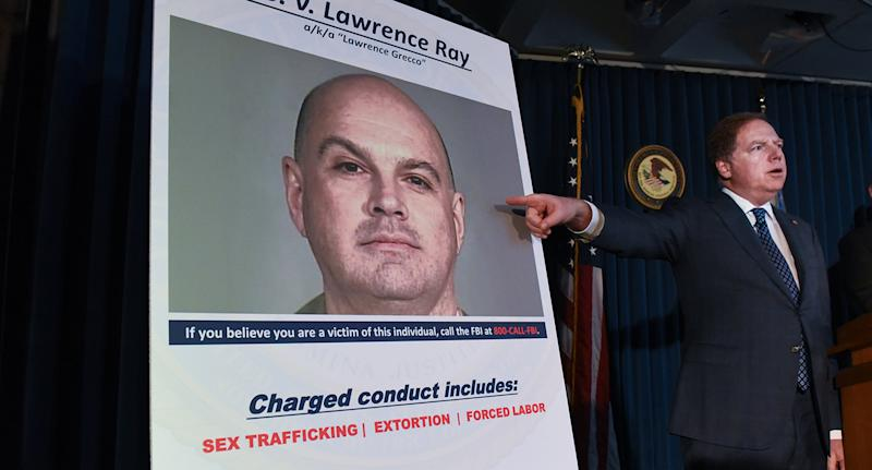 Geoffrey Berman, US Attorney for the Southern District of New York, points to a photo of Lawrence Ray.
