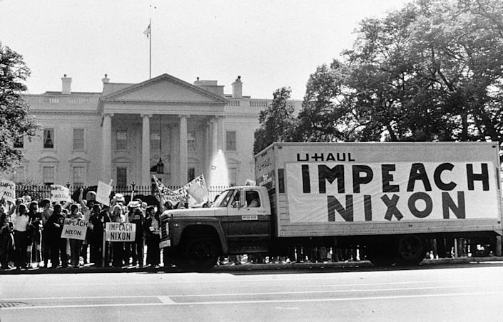 A demonstration outside the Whitehouse in support of the impeachment of President Nixon (1913 - 1994) following the Watergate revelations.   Getty Images
