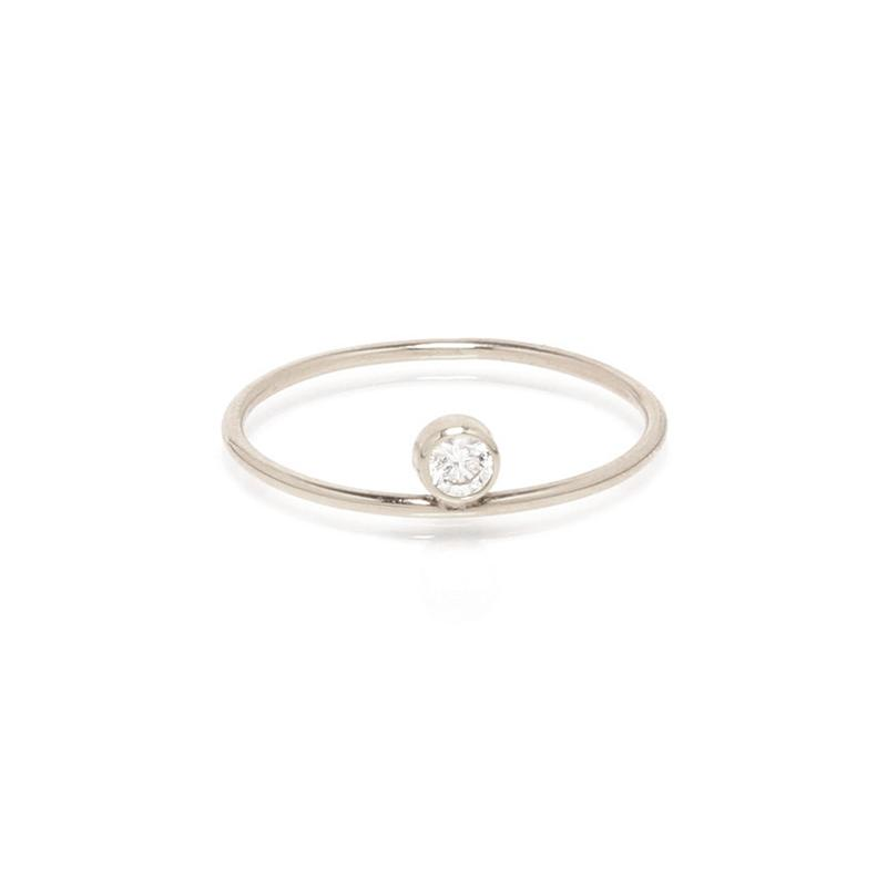 "<a rel=""nofollow"" href=""https://zoechicco.com/collections/rings/products/14k-single-bezel-diamond-ring"">14k Single Bezel Diamond Ring, Zoe Chicco, $375</a>"