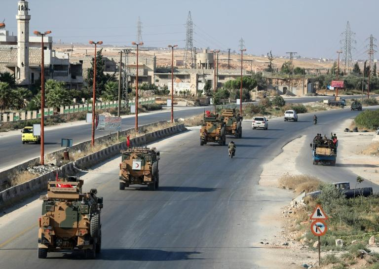 Turkish military convoys have become a common sight on the roads of Syria's jihadist-ruled Idlib region as Ankara resupplies its 12 observation posts (AFP Photo/Omar HAJ KADOUR)