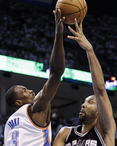 Oklahoma City Thunder power forward Serge Ibaka (9), from the Republic of Congo, blocks a shot by San Antonio Spurs center Tim Duncan (21) during the first half of Game 6 in the NBA basketball Western Conference finals, Wednesday, June 6, 2012, in Oklahoma City. (AP Photo/Eric Gay)