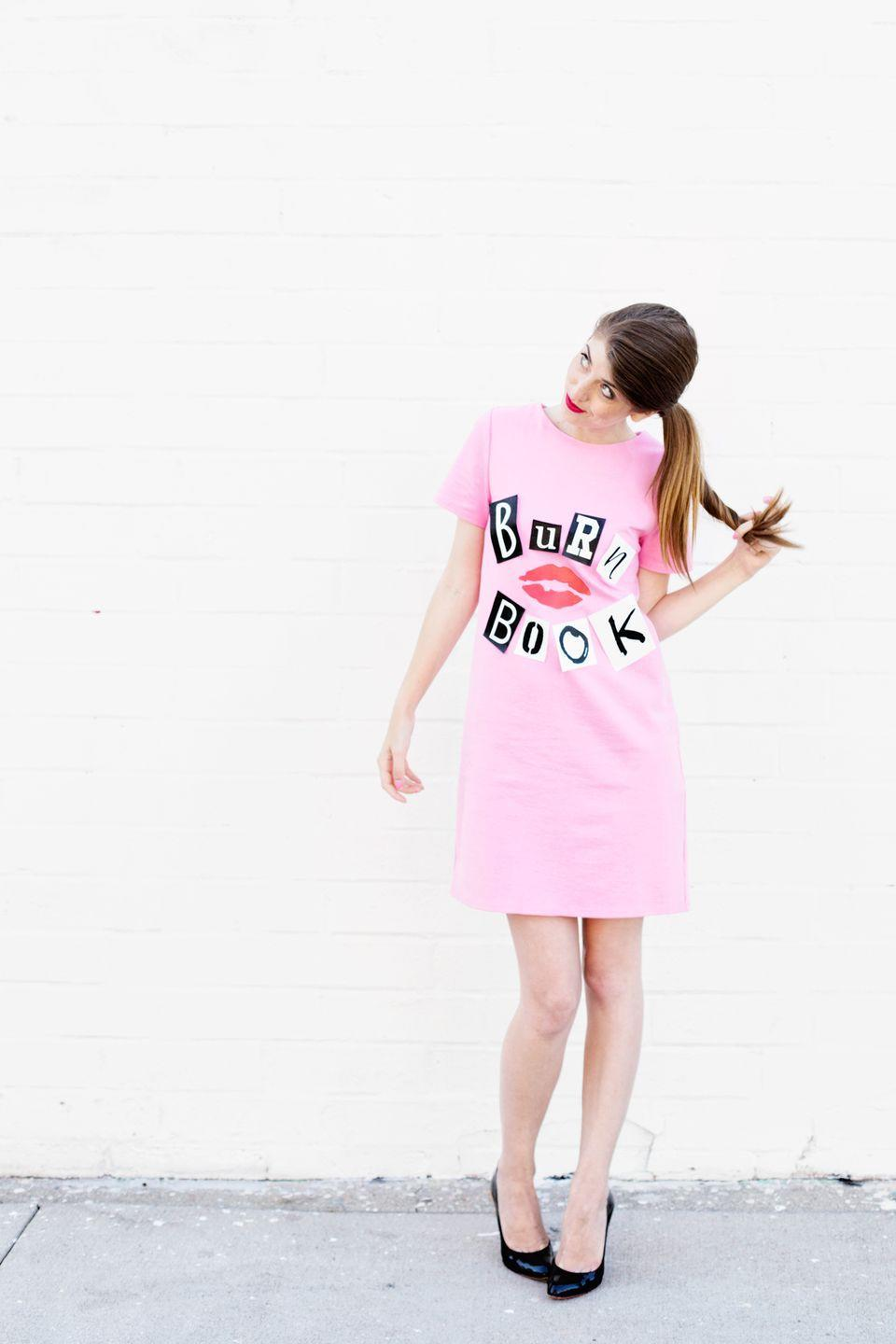 """<p>It doesn't get much easier than this costume inspired by <em>Mean Girls</em>. Just glue printed letters and a pair of lips to a pink T-shirt dress. </p><p><a class=""""link rapid-noclick-resp"""" href=""""https://studiodiy.com/diy-burn-book-costume/"""" rel=""""nofollow noopener"""" target=""""_blank"""" data-ylk=""""slk:GET THE TUTORIAL"""">GET THE TUTORIAL</a></p><p><a class=""""link rapid-noclick-resp"""" href=""""https://www.amazon.com/TOPONSKY-Womens-Casual-Sleeve-T-shirt/dp/B072DYNKMQ?tag=syn-yahoo-20&ascsubtag=%5Bartid%7C10072.g.33547559%5Bsrc%7Cyahoo-us"""" rel=""""nofollow noopener"""" target=""""_blank"""" data-ylk=""""slk:SHOP DRESS"""">SHOP DRESS</a></p>"""