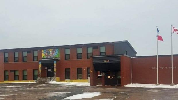 École Notre-Dame remains open after a positive case of COVID-19 was confirmed at the school on Thursday, Public Health said. (École Notre-Dame - image credit)