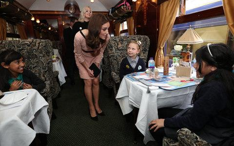 The Duchess of Cambridge speaks to children from the charities she supports onboard the Belmond British Pullman train at Paddington - Credit: Jonathan Brady/PA