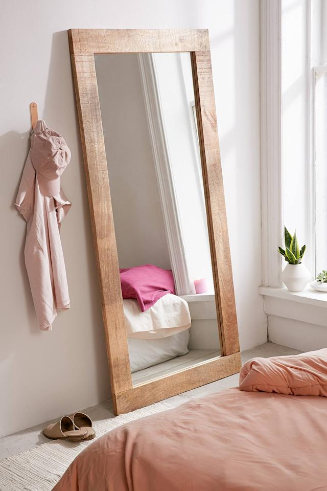"""<p>This <a href=""""https://www.popsugar.com/buy/Ashton-Mango-Wood-Mirror-556470?p_name=Ashton%20Mango%20Wood%20Mirror&retailer=urbanoutfitters.com&pid=556470&price=249&evar1=casa%3Aus&evar9=47304099&evar98=https%3A%2F%2Fwww.popsugar.com%2Fhome%2Fphoto-gallery%2F47304099%2Fimage%2F47304278%2FAshton-Mango-Wood-Mirror&list1=shopping%2Chome%20decor%2Cdecor%20shopping%2Chome%20shopping&prop13=api&pdata=1"""" rel=""""nofollow"""" data-shoppable-link=""""1"""" target=""""_blank"""" class=""""ga-track"""" data-ga-category=""""Related"""" data-ga-label=""""https://www.urbanoutfitters.com/shop/ashton-mango-wood-mirror2?category=apartment-room-decor&amp;color=020&amp;type=REGULAR&amp;size=ONE%20SIZE&amp;quantity=1"""" data-ga-action=""""In-Line Links"""">Ashton Mango Wood Mirror</a> ($249) also comes in a white wood finish.</p>"""