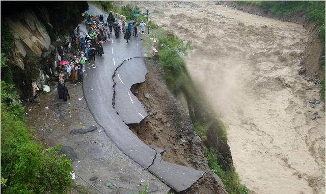 "In this handout photograph released by The Indian Army on June 18, 2013, Indian security personnel supervise residents and travellers as they stand on the remains of a flood damaged road alongside the River Alaknanda in Chamoli district in the northern Indian state of Uttarakhand on June 18, 2013. Torrential rains and flash floods washed away homes and roads in north India, leaving at least feared 60 people dead and thousands stranded, as the annual monsoon hit the country earlier than normal, officials said. Authorities called in military helicopters to try to rescue residents and pilgrims cut off by rising rivers and landslides triggered by more than three days of rain in the Himalayan state of Uttarakhand, officials said. -----EDITORS NOTE---- RESTRICTED TO EDITORIAL USE - MANDATORY CREDIT ""AFP PHOTO / INDIAN ARMY"" - NO MARKETING NO ADVERTISING CAMPAIGNS - DISTRIBUTED AS A SERVICE TO CLIENTS"