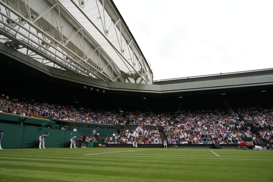 Switzerland's Roger Federer serves during the men's singles second round match against Richard Gasquet of France on day four of the Wimbledon Tennis Championships in London, Thursday July 1, 2021. (AP Photo/Alberto Pezzali)
