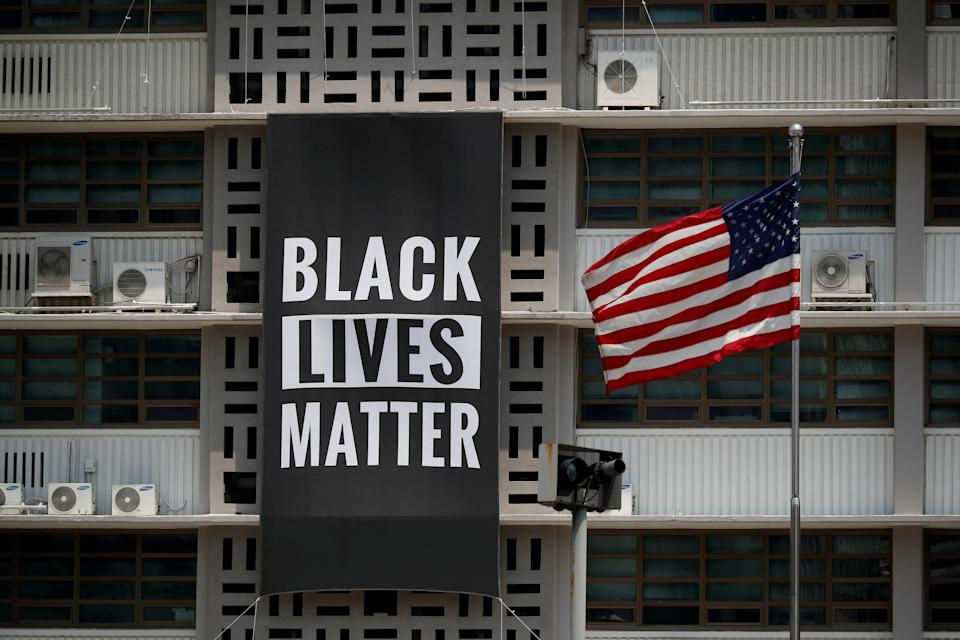 A huge Black Lives Matter banner is seen at the U.S. embassy in Seoul, South Korea, June 14, 2020.   REUTERS/Kim Hong-Ji     TPX IMAGES OF THE DAY
