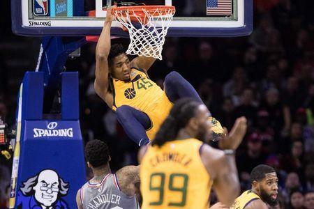 Nov 16, 2018; Philadelphia, PA, USA; Utah Jazz guard Donovan Mitchell (45) dunks against the Philadelphia 76ers during the second quarter at Wells Fargo Center. Bill Streicher-USA TODAY Sports