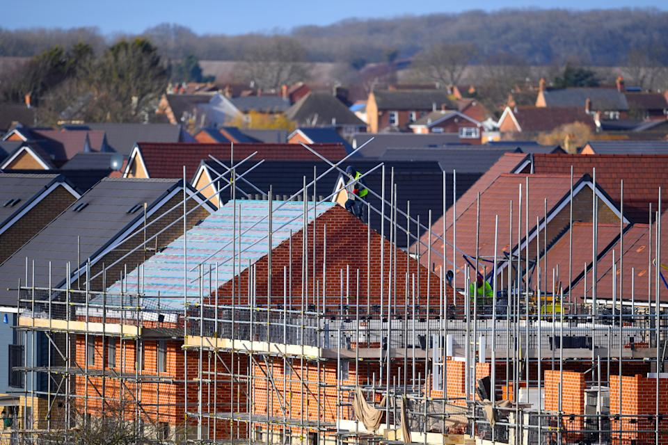 EMBARGOED TO 0001 FRIDAY OCTOBER 30 File photo dated 01/02/18 of houses under construction. The number of new homes registered to be built by the UK's housebuilders in the first three-quarters of 2020 was down by 30% on the same period last year, according to an industry body.