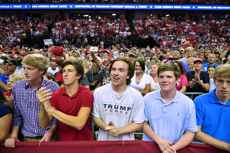 """Donald Trump has been repeating his message relentlessly in MAGA, or """"Make America Great Again,"""" rallies around the country, like here in Mississippi on October 2, 2018 (AFP Photo/MANDEL NGAN)"""