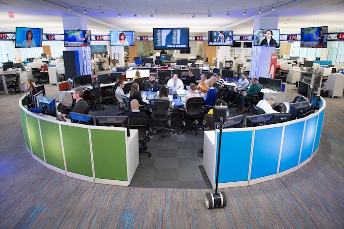 Staff gathers in the USA TODAY newsroom during a morning news meeting.