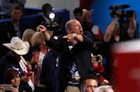 <p>A delegate shouts as a call for a roll call vote on the rules goes out during the opening day of the Republican National Convention in Cleveland, Monday, July 18, 2016. (AP Photo/Paul Sancya)</p>