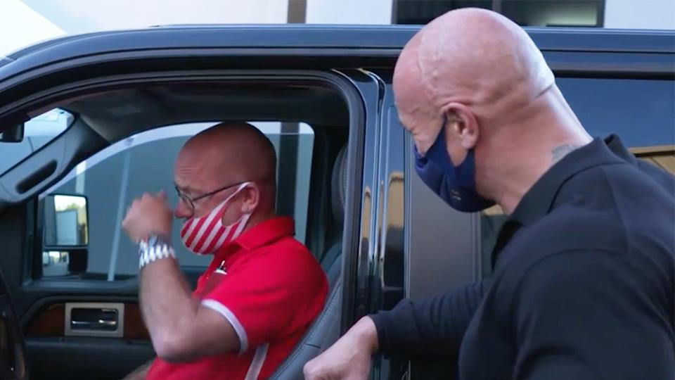 Dwayne, The Rock, Johnson (pictured right) laughing and surprising his friend Bruno Lauer (pictured left) crying with a new car.