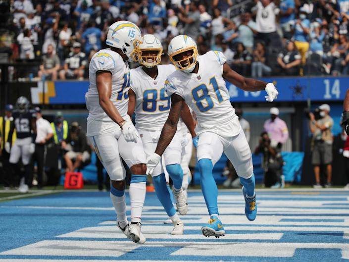 Chargers wide receiver Mike Williams (81) celebrates with teammates after scoring a touchdown during the first half.