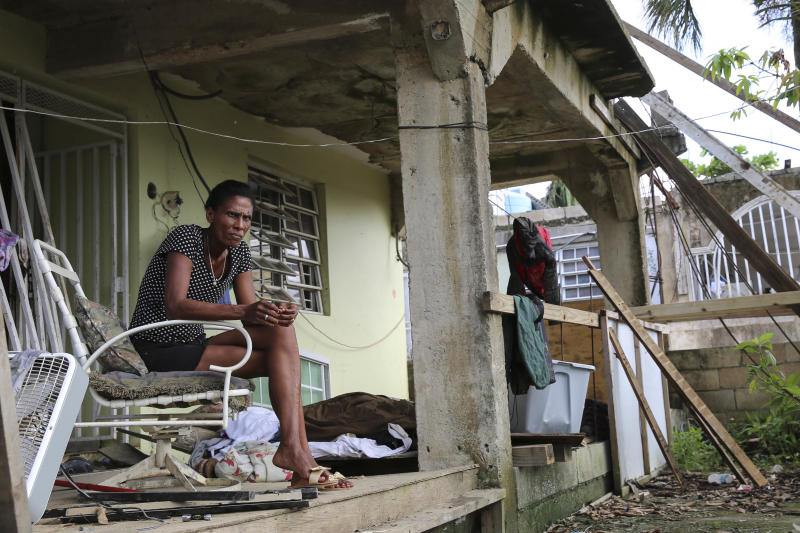 Juana Ferrera sits on the porch of her home in Valle Hill, Canóvanas, Puerto Rico. (Carolina Moreno/HuffPost)