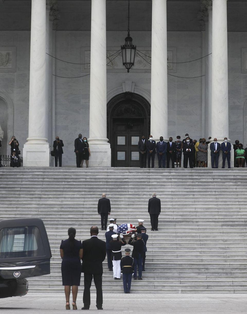 <p>A U.S. military honor guard carries the casket of former Rep. John Lewis (D-GA) up the U.S. Capitol steps prior to a memorial service in the Capitol Rotunda on July 27, 2020 in Washington, DC.</p>