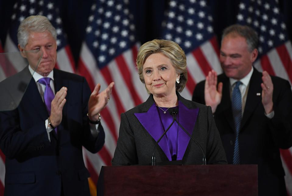 """<span class=""""s1"""">Hillary Clinton is joined by husband Bill Clinton and running mate Tim Kaine at a press conference the day after the 2016 election. (Photo: Matt McClain/The Washington Post via Getty Images)</span>"""