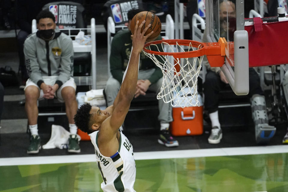 Milwaukee Bucks forward Giannis Antetokounmpo dunks the ball during the second half against the Phoenix Suns in Game 4 of basketball's NBA Finals in Milwaukee, Wednesday, July 14, 2021. (AP Photo/Paul Sancya)