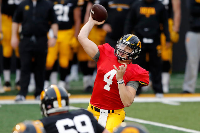 Iowa quarterback Nate Stanley (4) throws a pass during the team's NCAA college football spring scrimmage, Friday, April 20, 2018, in Iowa City, Iowa. (AP Photo/Charlie Neibergall)
