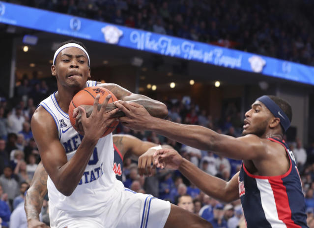 Memphis' D. J. Jeffries (0) grabs a rebound while Mississippi Blake Hinson (0) defends in the first half of an NCAA college basketball game Saturday, Nov. 23, 2019, in Memphis, Tenn. (AP Photo/Karen Pulfer Focht)