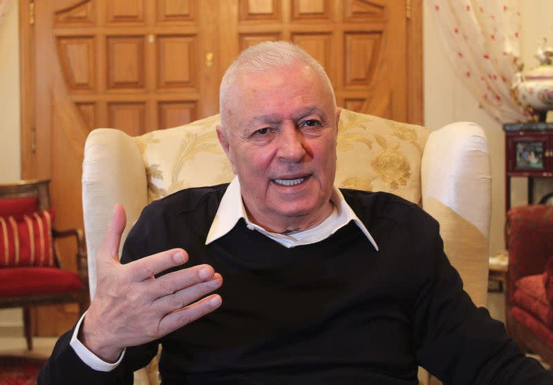 Syrian businessman George Haswani, talks during an interview with Reuters in Damascus