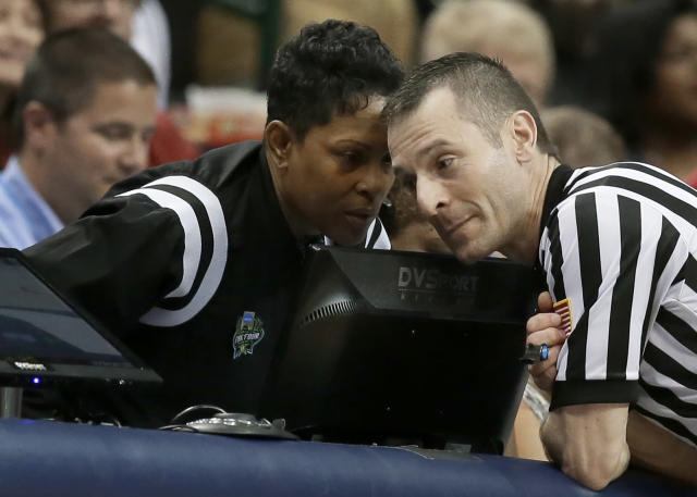 File-In this March 31, 2017, file photo, official Rachelle Jones, left, talks with another official during a practice session for the women's NCAA Final Four college basketball tournament in Dallas. The veteran womens basketball official died June 18, 2018, in a hospital after battling cancer off and on for the past seven years. The 51-year-old Jones had been one of the top referees for the past few years and was rewarded with her first Final Four in 2017. Jones served as an alternate official in Dallas and handled off-court duties, such as assisting with instant replay reviews. (AP Photo/LM Otero, File)