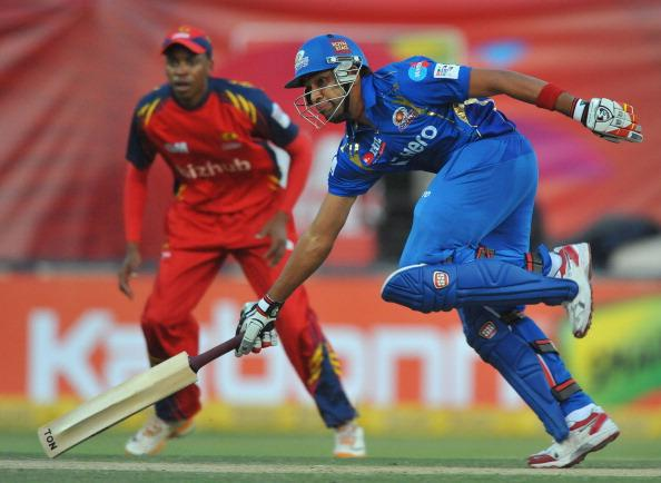 JOHANNESBURG, SOUTH AFRICA - OCTOBER 14:  Rohit Sharma of Mumbai runs a singlee during the Karbonn Smart CLT20 match between bizhub Highveld Lions and Mumbai Indians at Bidvest Wanderers Stadium on October 14, 2012 in Johannesburg, South Africa. (Photo by Duif du Toit / Gallo Images/Getty Images)