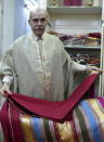 Lasaad El Beji Amine El Hrairia, a silk weaver In Tunis' Medina and that Hassan Ben Ayech, the designer for the Bardo Collection, uses, holds a fabric in Tunis, Monday Oct.5 , 2020. El Béji is an example of a local Tunisian artisan whose craft and production of high-quality hand-made material is being incorporated by these new sustainable fashion brands. (AP Photo/Hassene Dridi)