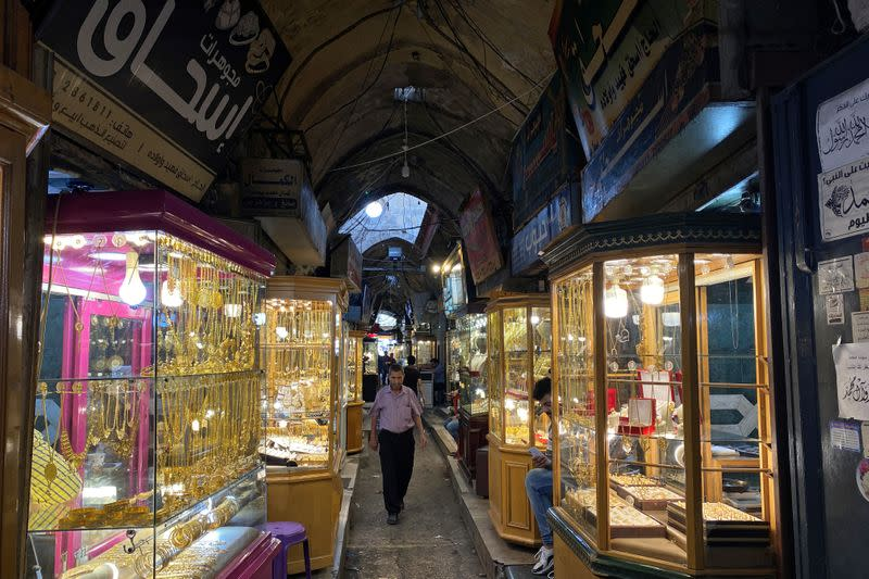 A Palestinian man walks past jewellery shops at the gold market in Gaza City