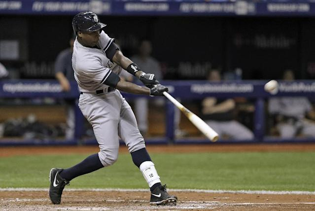 New York Yankees' Alfonso Soriano connects for a home run off Tampa Bay Rays starting pitcher David Price during fifth inning of a baseball game on Thursday, April 17, 2014, in St. Petersburg, Fla. (AP Photo/Chris O'Meara)