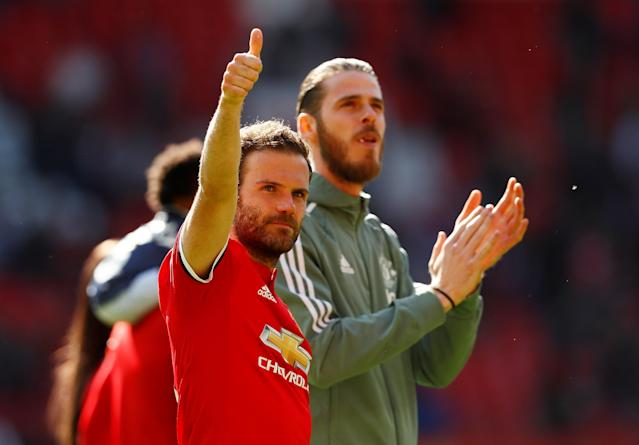 "Soccer Football - Premier League - Manchester United vs Watford - Old Trafford, Manchester, Britain - May 13, 2018 Manchester United's Juan Mata with David De Gea applaud their fans after the match Action Images via Reuters/Jason Cairnduff EDITORIAL USE ONLY. No use with unauthorized audio, video, data, fixture lists, club/league logos or ""live"" services. Online in-match use limited to 75 images, no video emulation. No use in betting, games or single club/league/player publications. Please contact your account representative for further details."