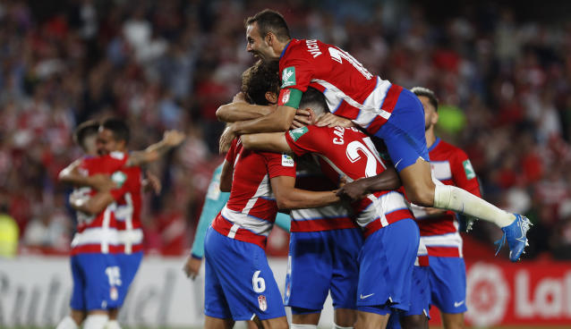 Granada's players celebrate at the end of the match during the Spanish La Liga soccer match between Barcelona and Granada at the Los Carmenes stadium in Granada, Spain, Saturday, Sep. 21, 2019. Granada won 2-0. (AP Photo/Miguel Morenatti)