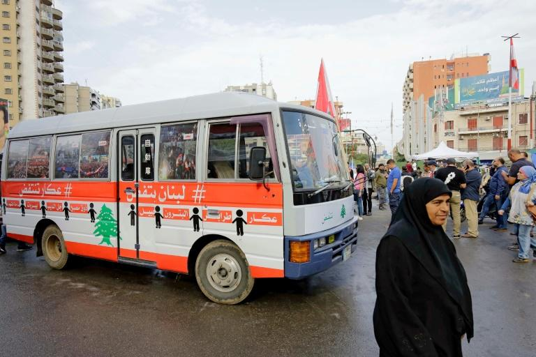 """A so-called """"revolution bus"""" traversed the multi-religious country from north to south (AFP Photo/Ibrahim CHALHOUB)"""