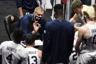 BYU head coach Mark Pope talks to his team in the first half of an NCAA college basketball game against Southern California, Tuesday, Dec. 1, 2020, in Uncasville, Conn. (AP Photo/Jessica Hill)