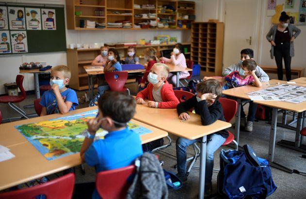 Pupils listen to their teacherat primary school on July 6, 2021. (Photo: INA FASSBENDER via Getty Images)