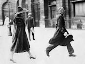 <p>Dietrich - pictured here as the epitome of European elegance - is escorted by a porter into a fashion house in Paris draped in an almost floor-length fur coat and wide-brim hat. </p>